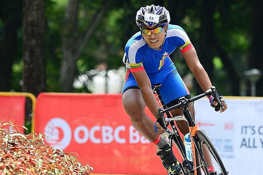 Thant Thiha Dway rounding a corner in the OCBC Cycle Speedway South-east Asia Championship yesterday. Myanmar were only the fourth quickest team but won as the Philippines, Thailand and Singapore all incurred infringements.