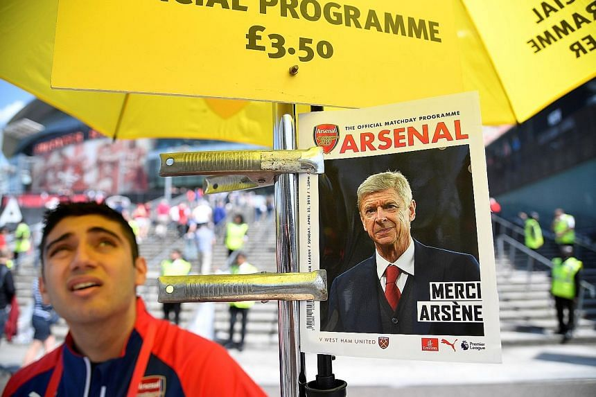 """A promotional poster for the official match-day programme of the Arsenal-West Ham game on April 22, when news first broke that the Frenchman would be leaving the club after 22 years in charge. Wenger said his successor will have to make the club """"the"""