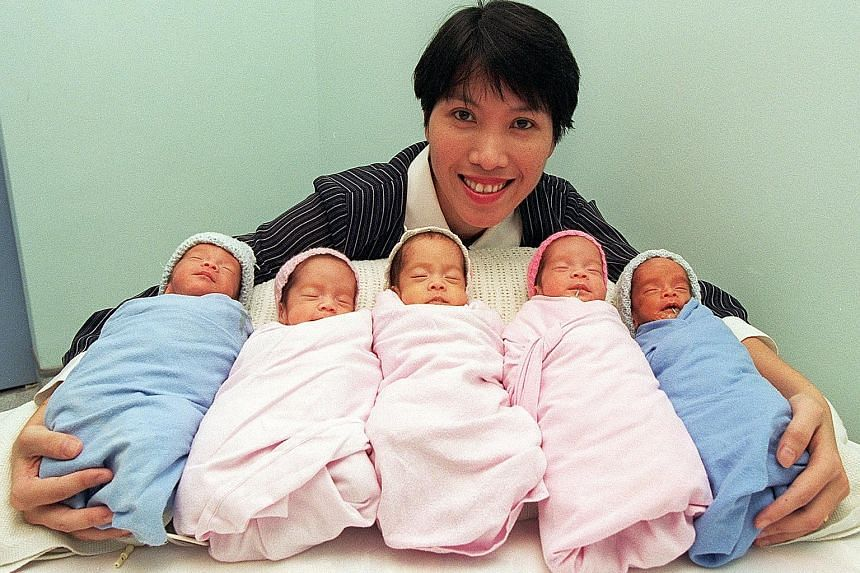 Above: Mrs Dorothy Chin with her brood of five - (from left) Adriel, Alicia, Amanda, Annabelle and Andre - who were born in that order on April Fool's Day in 1997. The two boys and three girls were the first set of quintuplets to be born in Singapore