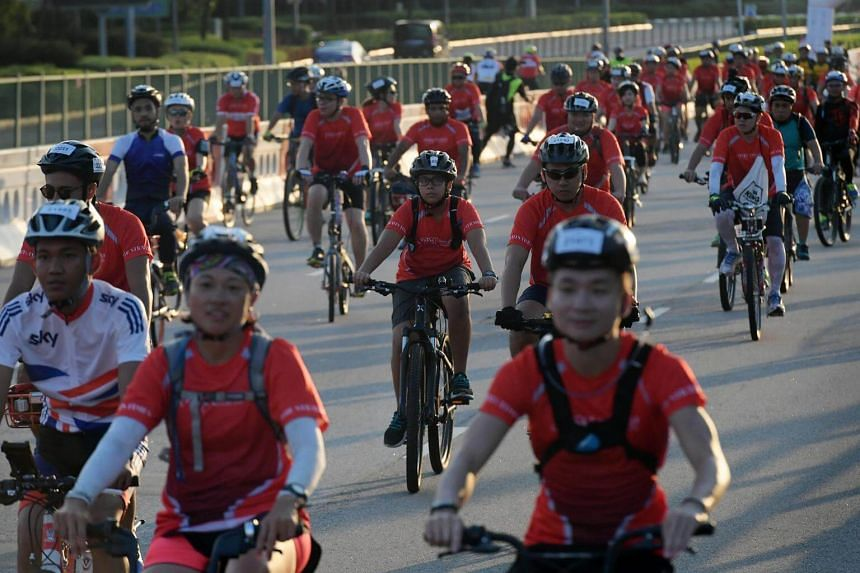 Participants of The Straits Times Ride, part of OCBC Cycle 2018, set off from the starting point near the Singapore Sports Hub.