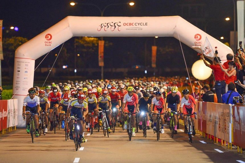 Participants of OCBC Cycle's Sportive Ride making their way off the start point at the Singapore Sports Hub.
