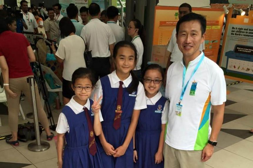 Mr Ong with pupils from CHIJ Our Lady Queen of Peace at the launch of a Clean and Green campaign in 2015.