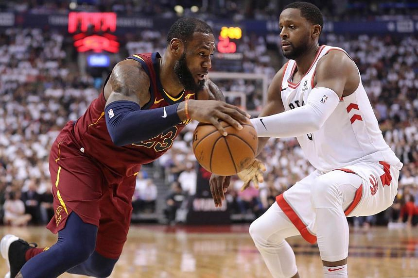 Cleveland Cavaliers forward LeBron James moves to the basket against Toronto Raptors forward C.J. Miles at the Air Canada Centre, on May 3, 2018.