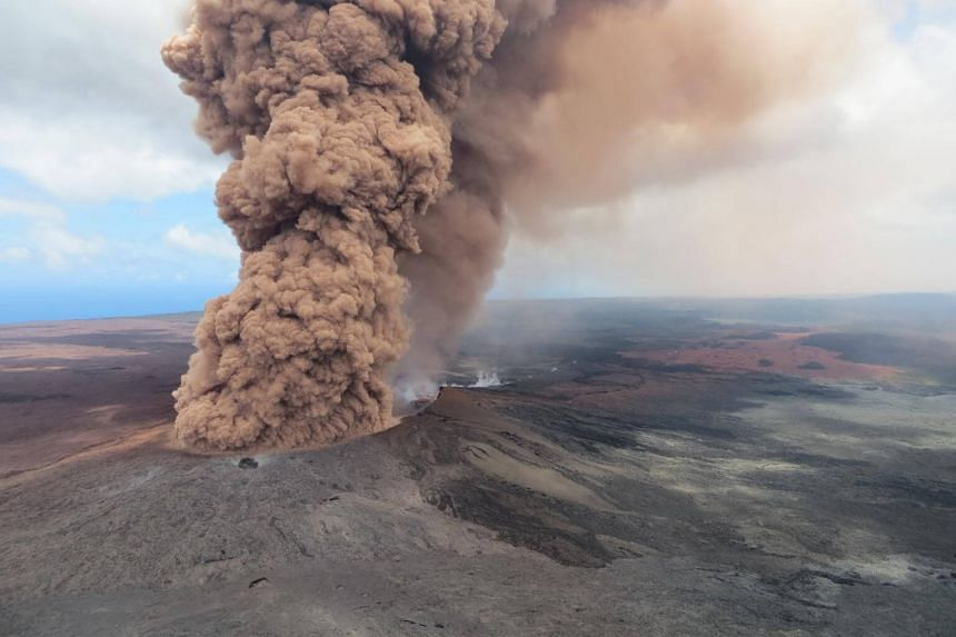 A plume of ash rising from a crater on Mount Kilauea in Hawaii after a magnitude 6.9 earthquake struck the area on May 4, 2018.