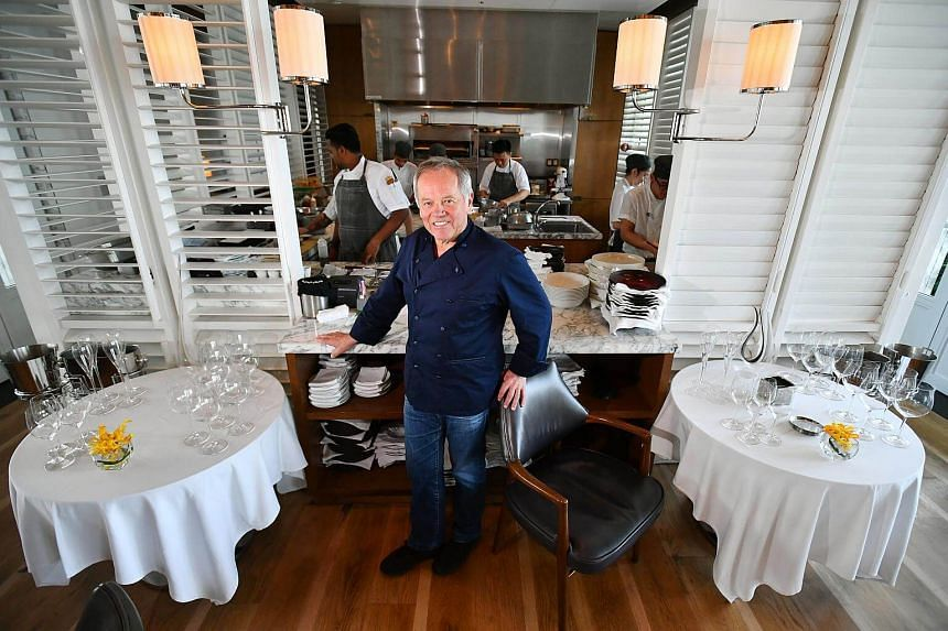 Chef Wolfgang Puck at Spago Singapore at Marina Bay Sands during a visit last month. The 68-year-old, whose empire spans more than 25 fine-dining restaurants and over 70 casual dining outlets, says that chefs must remain curious and be open to trying