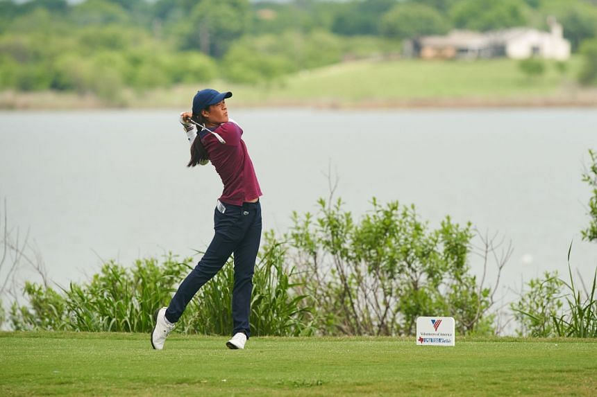 Boutier of France plays a tee shot at the second hole during the continuation of the first round.