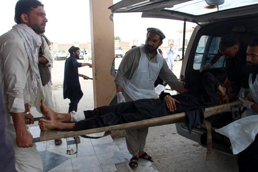 An injured man being carried out of a voter registration centre after an explosion, in Khost province, Afghanistan, on May 6, 2018.