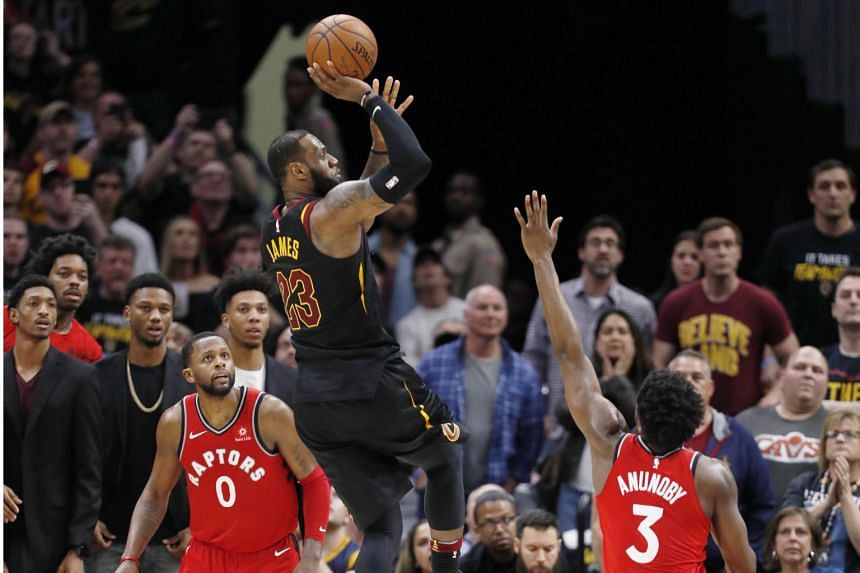 Cleveland Cavaliers forward LeBron James taking a shot over Toronto Raptors forward OG Anunoby (right) during their NBA playoffs match on May 5, 2018.