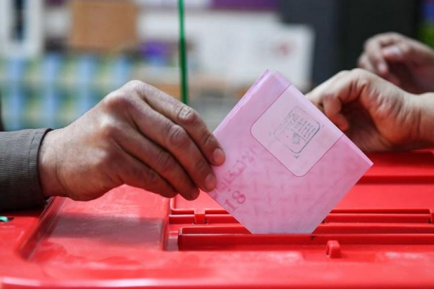 A Tunisian casting his ballot at a voting booth in Ben Arous on May 6, 2018.