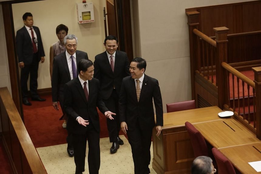 Prime Minister Lee Hsien Loong arriving for the opening of the second session of Parliament with (clockwise from top left) Ms Josephine Teo, Mr Zaqy Mohamad, Mr Alex Yam and Mr Chan Chun Sing.
