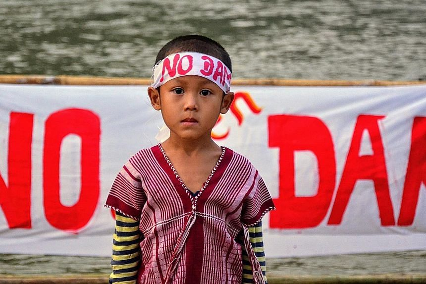 A child taking part in a protest against a massive hydropower dam being built in eastern Myanmar.