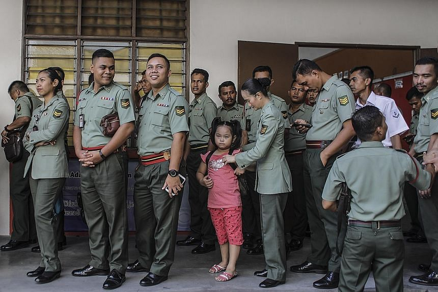 Early voting in Kuala Lumpur last Saturday ahead of Malaysia's 14th General Election on Wednesday. In Singapore, there could be a shift in focus to the polls as many Malaysians living in the city-state make their way home to cast their votes.