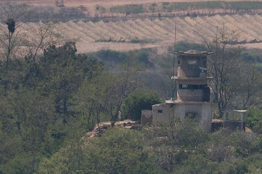 Photographs of a North Korean guard post released last Saturday showing it with (left) and without a propaganda loudspeaker installation.
