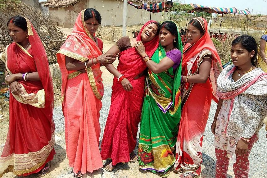 Relatives on Saturday mourning the death of the 16-year-old girl at Raja Kundra Village in Chatra district in the eastern Indian state of Jharkhand. So far 15 people have been arrested in the case, according to the police.