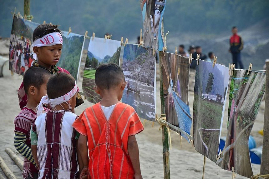 Children (above) join an event calling for the halt of dam-building on the Salween river (left). Several sites along the major waterway have been earmarked for hydropower dams, including the Mong Ton Hydropower project.