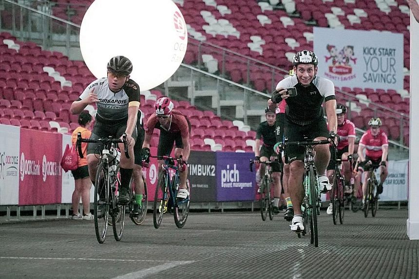Above: Software developer Eugene Ranada, 45, taking part in OCBC Cycle's The Sportive Ride at the Singapore Sports Hub yesterday.