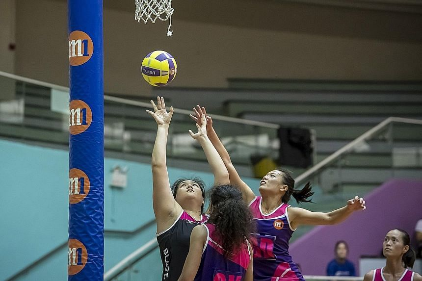 The Blaze Dolphins' Lee Pei Shan attempts a shot against the Sneakers Stingrays in the preliminary final yesterday. The Dolphins won 47-41 and will meet defending champions the Mission Mannas in the M1 Netball Super League grand final at the Toa Payo