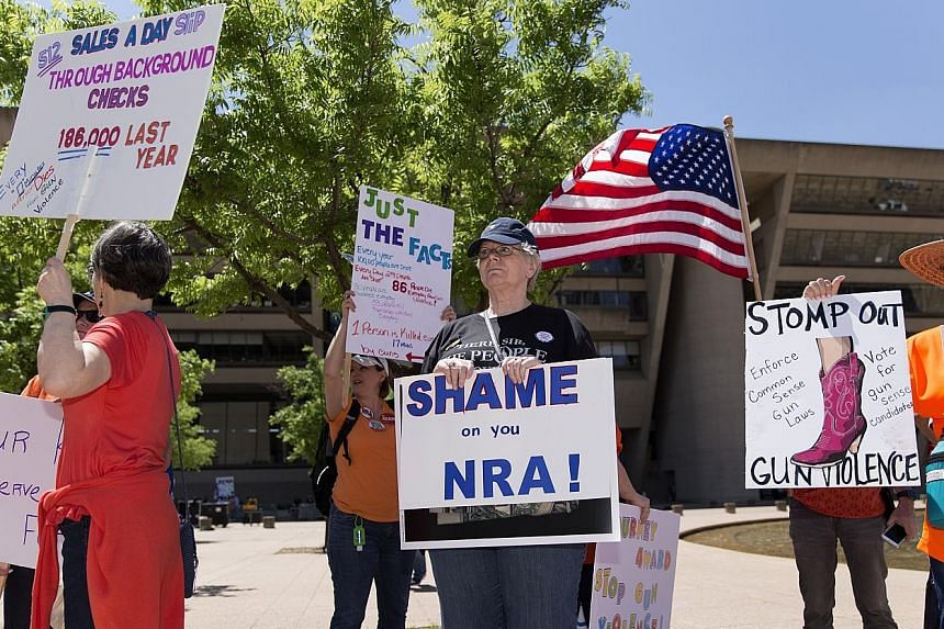 Above: A protest against gun ownership and violence in Dallas, Texas, on Saturday, on the sidelines of the National Rifle Association's (NRA) annual meeting. Left: President Donald Trump at the NRA meeting on Friday, where he made the controversial s