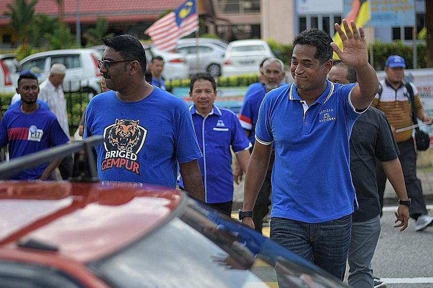 Mr Khairy Jamaluddin, one of the most recognisable faces of ruling coalition Barisan Nasional, greeting residents during a walkabout in Seremban last Thursday.