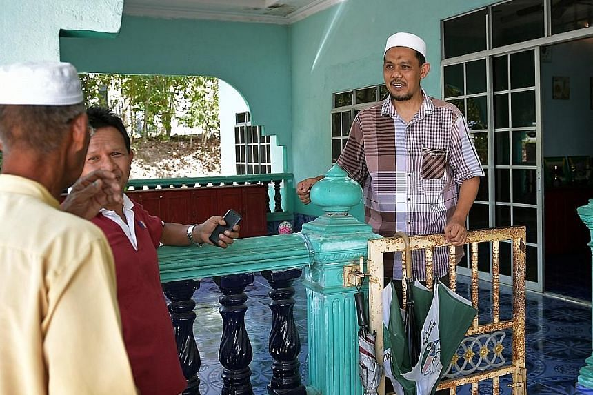 PAS parliamentary candidate Radhi Mat Din at his home in Pokok Sena, Kedah. The former footballer peppers his campaign speeches with football analogies, to claps and laughter.