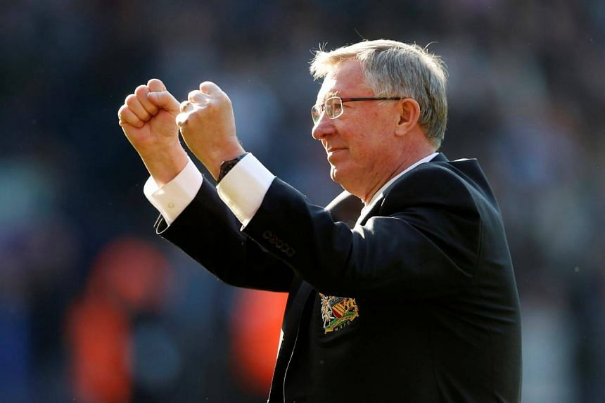 Former Manchester United manager Alex Ferguson saluting fans after the English Premier League match against West Bromwich Albion on May 19, 2013.
