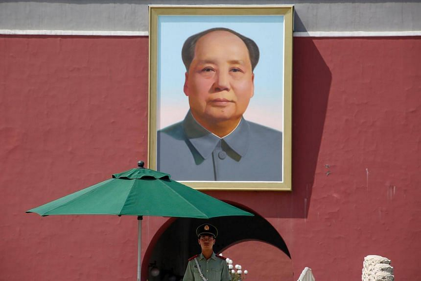 A policeman keeping watch underneath the portrait of former Chinese Chairman Mao Zedong in Beijing's Tiananmen Square.