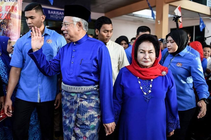 Malaysia's Prime Minister Najib Razak (centre) and his wife Rosmah Mansor meeting supporters as they arrive at the nomination centre to hand over election documents in Pekan, on April 28, 2018.