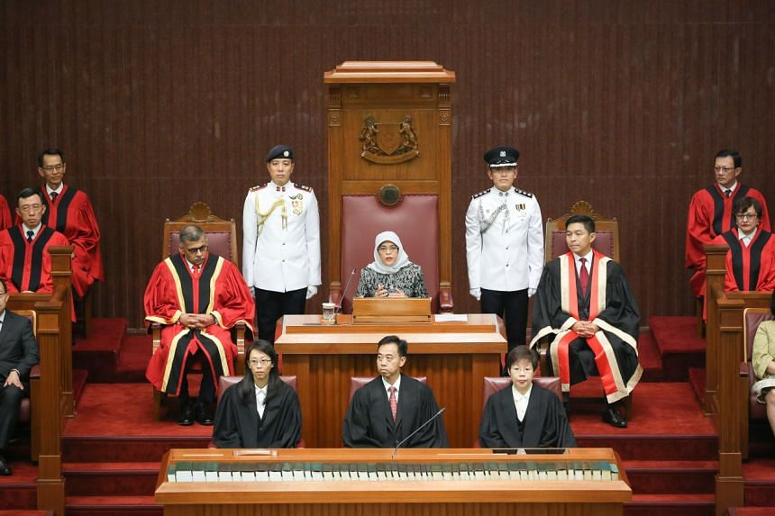 President Halimah Yacob speaking at the opening of the second session of the 13th Parliament in Parliament House, flanked by Chief Justice Sundaresh Menon and Speaker of Parliament Tan Chuan-Jin, on May 7, 2018.