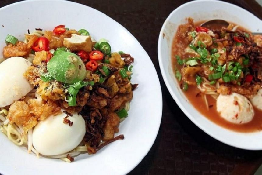 The popular mee rebus (left) and mee rojak at Mastan Ghani.