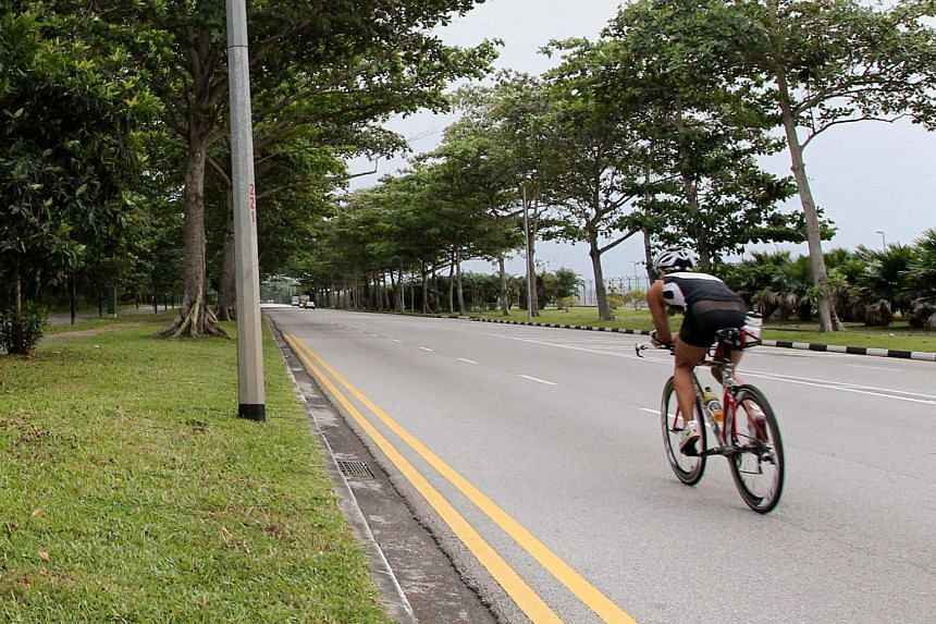 File photo of a cyclist on the road. Mr Benjamin Paul Lawrance, 32, died when a taxi from the opposite direction crashed into him as he was cycling along Mandai Road just after on July 14, 2014.