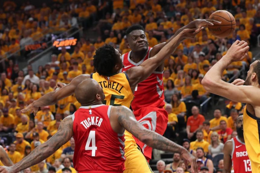 Houston Rockets centre Clint Capela blocks a shot by Utah Jazz guard Donovan Mitchell during the fourth quarter in game four of the second round of the 2018 NBA Playoffs in Salt Lake City on May 6, 2018.