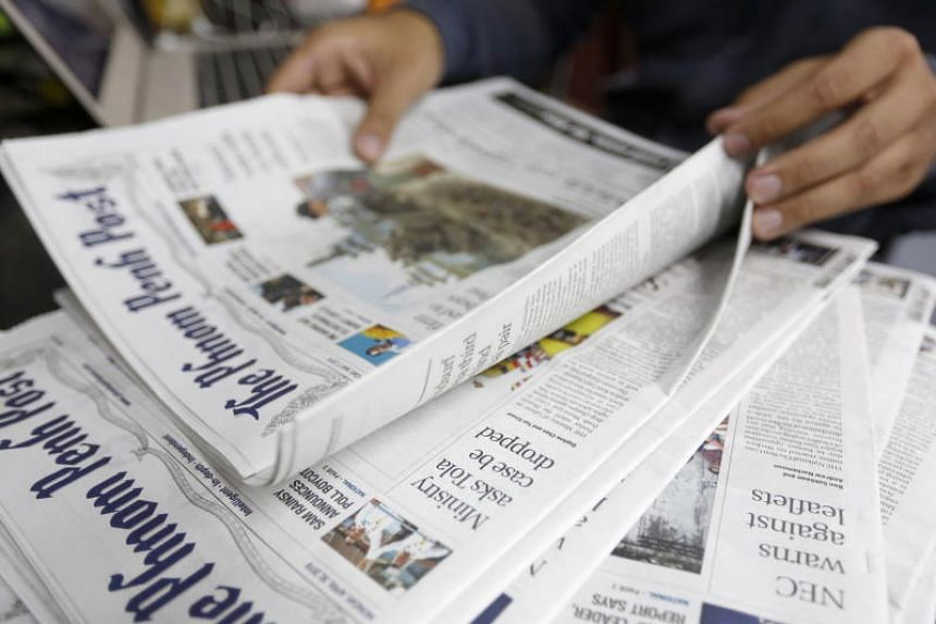 A person reads an issue of The Phnom Penh Post newspaper at an office in Phnom Penh, Cambodia, on May 7, 2018.