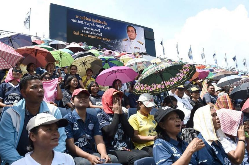 "People arrive to greet Thai Prime Minister Prayut Chan-o-cha at Buriram FC's ""Thunder Castle"" stadium in Buriram on May 7, 2018."