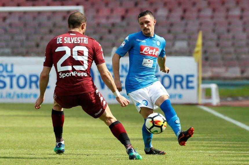 Napoli's Mario Rui in action with Torino's Lorenzo De Silvestri.