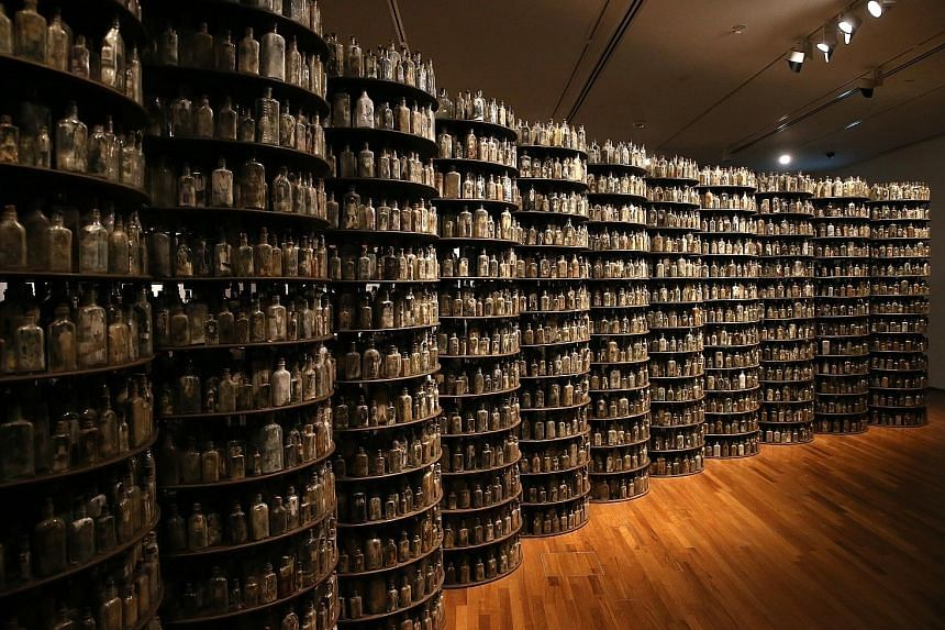 Thai artist Navin Rawanchaikul's Asking For Nothingness comprises 11,000 old medicine bottles - half filled with black-and-white photographs of elderly villagers.