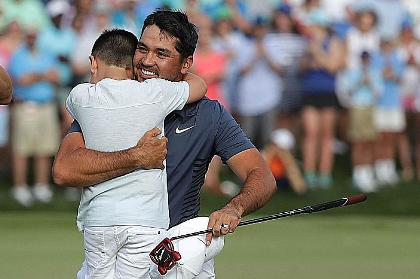 Jason Day of Australia celebrating with his son Dash on the 18th green at Quail Hollow Club after winning the Wells Fargo Championship in North Carolina on Sunday. The victory elevated the 30-year-old to world No. 7 yesterday after a winless 2017.