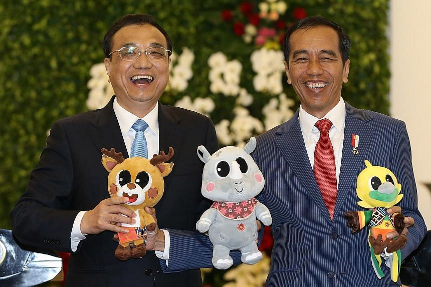 Chinese Premier Li Keqiang and Indonesian President Joko Widodo sharing a light-hearted moment as they hold up the mascots of the 2018 Asian Games during a meeting at Istana Bogor in West Java yesterday. The talks included discussions on regional sec