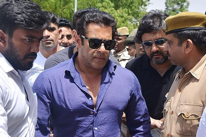 Bollywood star Salman Khan leaving after the court hearing in Jodhpur which was held at an earlier-than-usual time yesterday.