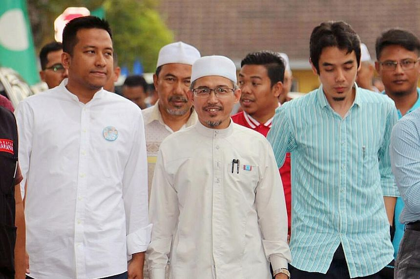Mr Nik Omar (centre), eldest son of late PAS leader Nik Aziz Nik Mat, on the campaign trail in Shah Alam, Selangor. He has come under fire from his mother and a brother for contesting under the opposition PH banner.