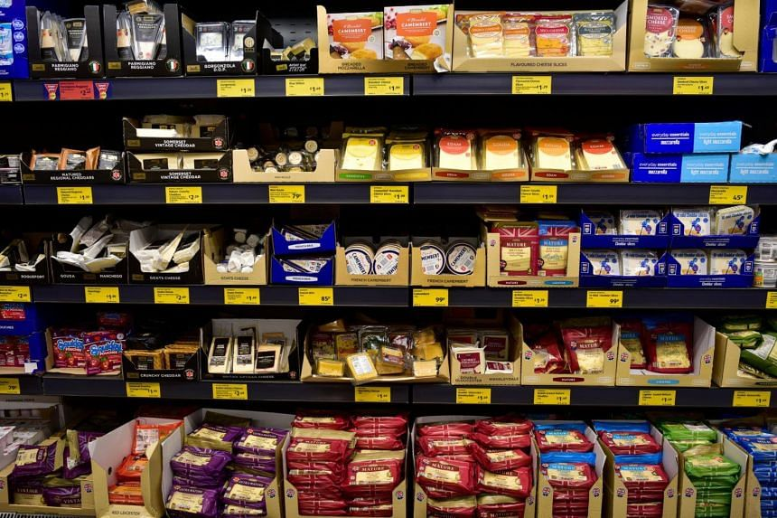 A range of various cheeses on sale in an Aldi store in London.