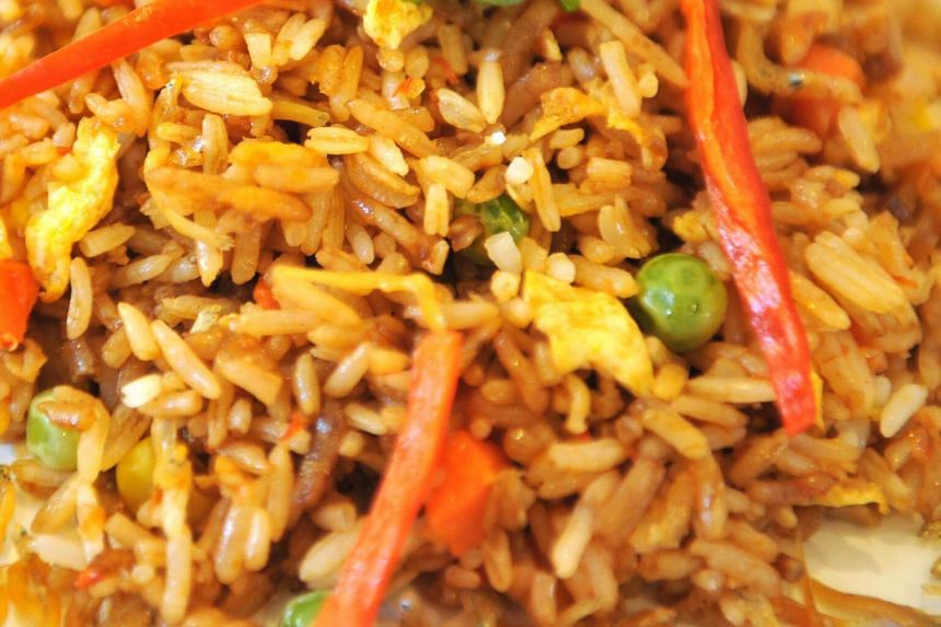 File photo showing a plate of fried rice and vegetables.