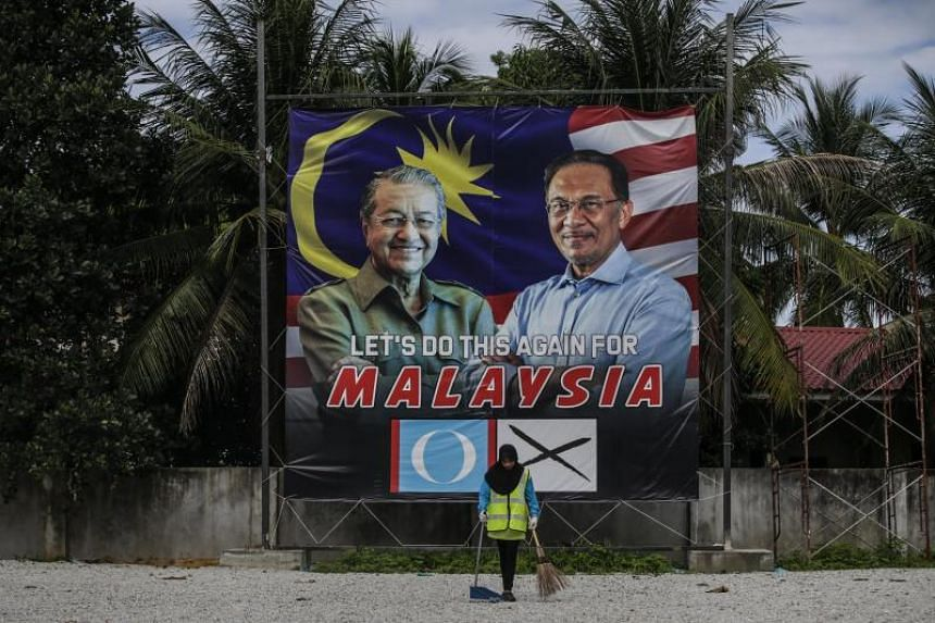 A billboard showing former Malaysian prime minister Mahathir Mohamad and former opposition party leader Anwar Ibrahim in Langkawi, on April 27, 2018.
