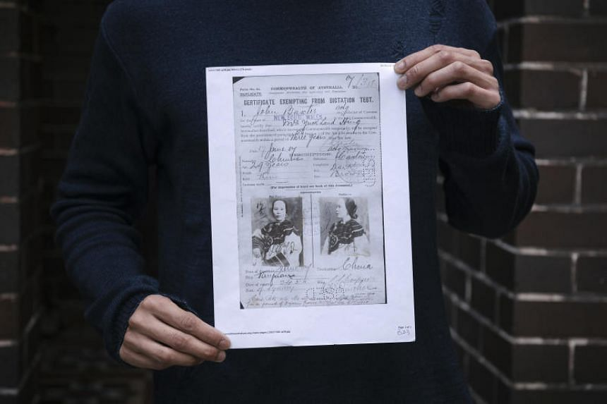 Ken Leanfore holds a copy of a certificate, dated 1901, issued to one of his ancestors to exempt them from a dictation test that was commonly used to exclude nonwhite immigrants in Sydney, on April 30, 2018.