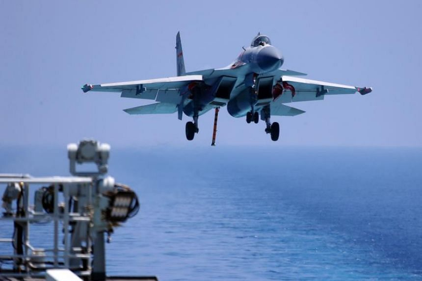 A J15 fighter jet preparing to land on China's sole operational aircraft carrier, the Liaoning, during a drill at sea on April 14, 2018.