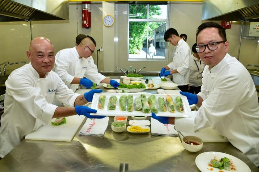 HCSA Academy Culinary Training Centre trainees Colin Chan (left), 55, and Dwight Soriano, 33, at the launch of the centre on May 8, 2018.