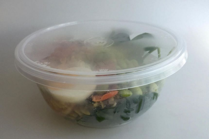 Takeway food in a clear plastic container. Cooked food should be collected and consumed at about the same time.