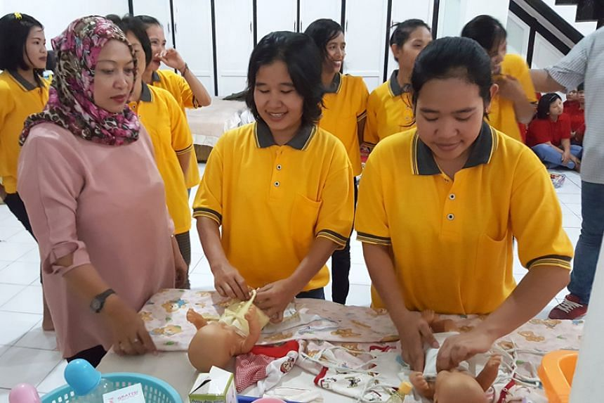 Domestic workers being trained in Jakarta. Since April 2018, employers hiring a new Indonesian maid in Singapore have been asked to purchase a performance bond guarantee.