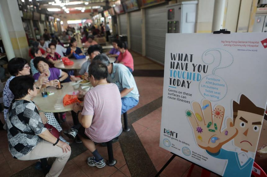 Marketgoers and hawkers were shown the correct hand-washing method by members of Ng Teng Fong General Hospital's infection control team and then had the opportunity to test their knowledge.