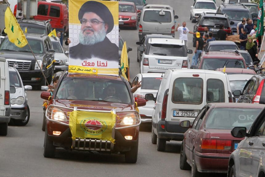 A car with the picture of Hizbollah leader Sayyed Hassan Nasrallah on the streets of Bint Jbeil, southern Lebanon, on May 6, 2018.