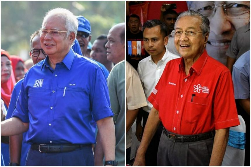 PM Najib Razak (left) sought to take back the initiative from rival Tun Mahathir Mohamad as Malaysia's 14th general election enters its final day of campaigning.